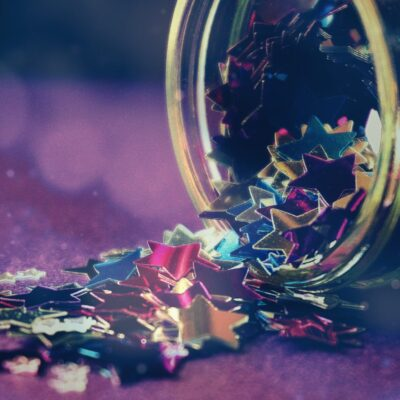 A jar of stars confetti, spilling out